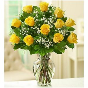 Yellow roses in vase as gift
